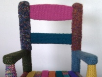 A photo of Yarn Bombed Childs Rocker